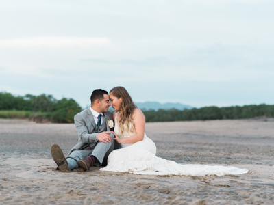 Bride and groom sharing a beautiful moment on the beach in Tamarindo, Costa Rica. Photographed by Kristen M. Brown, Samba to the Sea Photography.