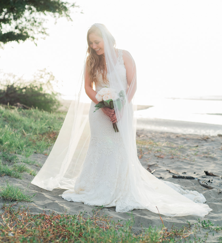 Bridal portrait on the beach in Tamarindo, Costa Rica. Photographed by Kristen M. Brown, Samba to the Sea Photography.