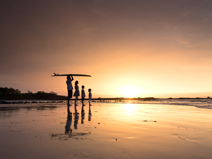 Endless Summer sunset in Tamarindo, Costa Rica during family photos on the beach. Photographed by Kristen M. Brown, Samba to the Sea Photography.