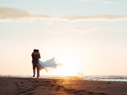 Husband spinning his wife on the beach during sunset in Tamarindo, Costa Rica. Photographed by Kristen M. Brown, Samba to the Sea Photography.