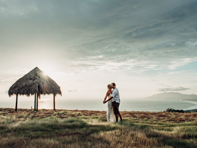 Bride and groom dancing with a gorgeous view of the ocean in Costa Rica.