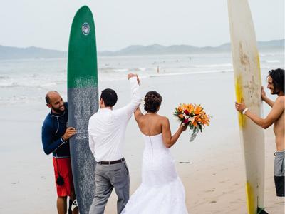 Bride and groom walking on the beach in Tamarindo Costa Rica.