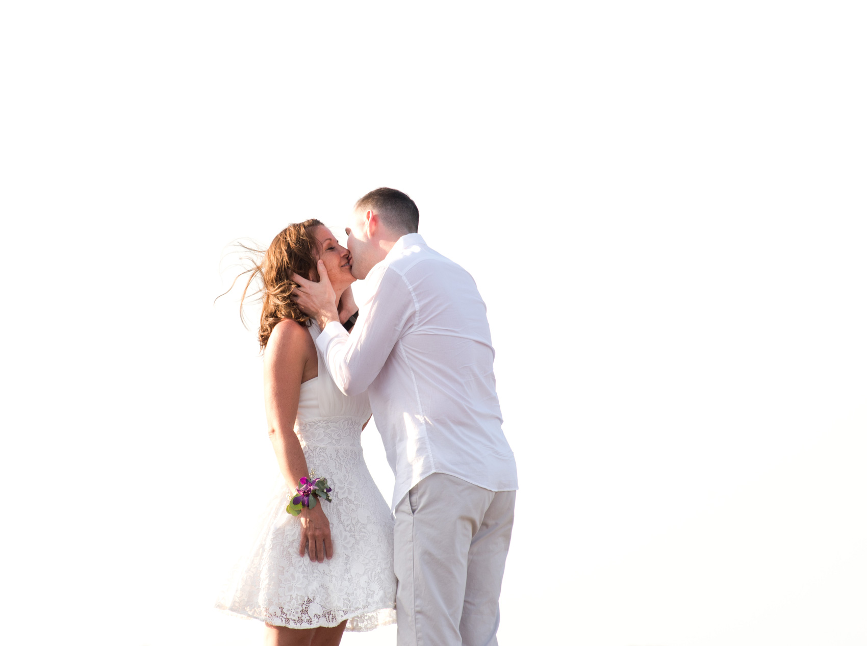Jacinta and Ryan kissing after saying their vows on the beach in Tamarindo, Costa Rica. Photographed by Kristen M. Brown, Samba to the Sea Photography.
