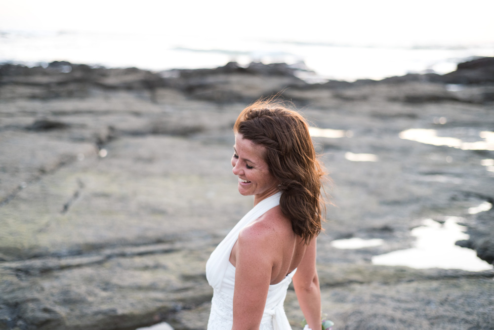 Bride twirling on the low tide rocks in Tamarindo, Costa Rica. Photographed by Kristen M. Brown, Samba to the Sea Photography.