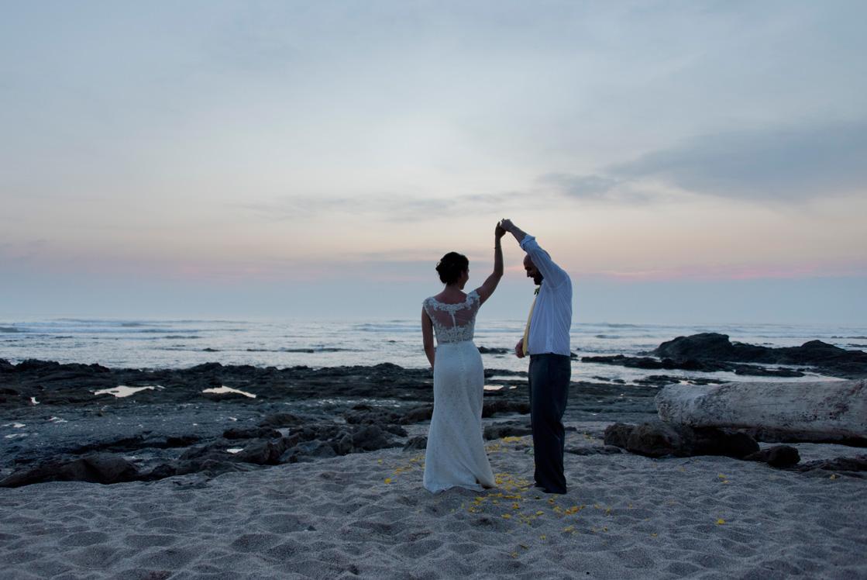 Groom twirling bride during Wedding in Playa Langosta, Costa Rica