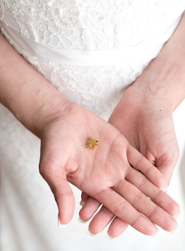 Alpha Phi sorority sister about to get married holding sorority pin