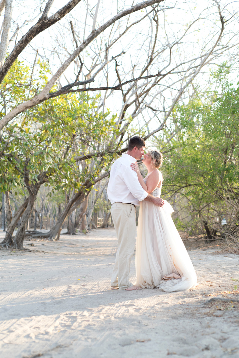 Romantic kiss at The Westin at Playa Conchal, Costa Rica.Photographed by Kristen M. Brown, Samba to the Sea Photography.
