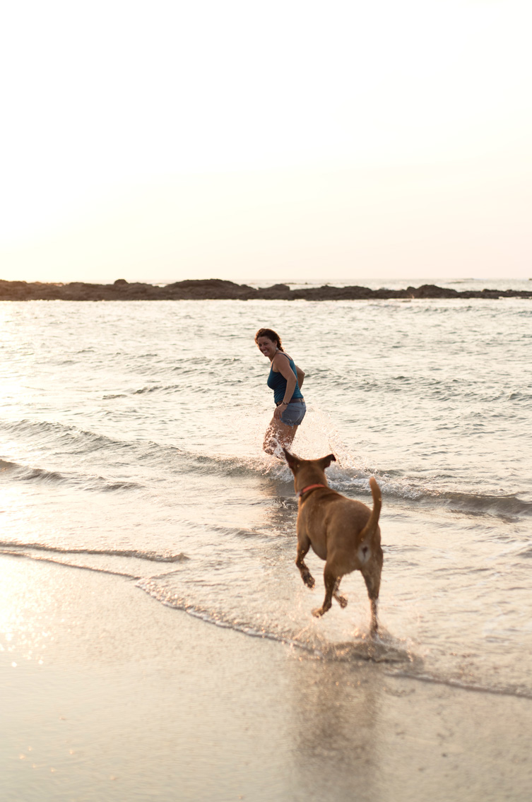 Maverick the Ridgeback mix chasing his owner down the beach in Tamarindo, Costa Rica. Photographed by Kristen M. Brown, Samba to the Sea Photography.