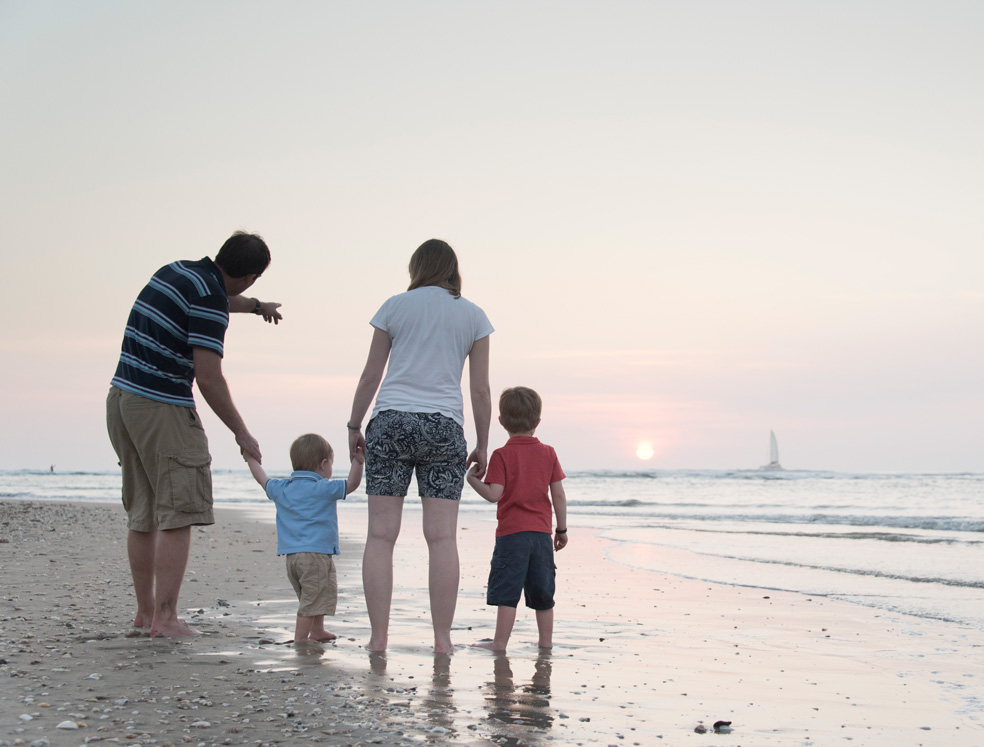 Family enjoying a sunset in Tamarindo, Costa Rica. Photographed by Kristen M. Brown, Samba to the Sea Photography.