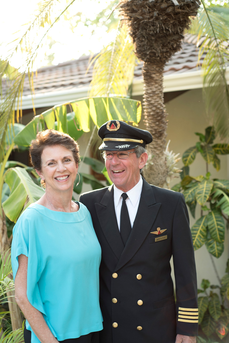 Delta pilot and his wife on vacation in Tamarindo, Costa Rica. Photographed by Kristen M. Brown, Samba to the Sea Photography.
