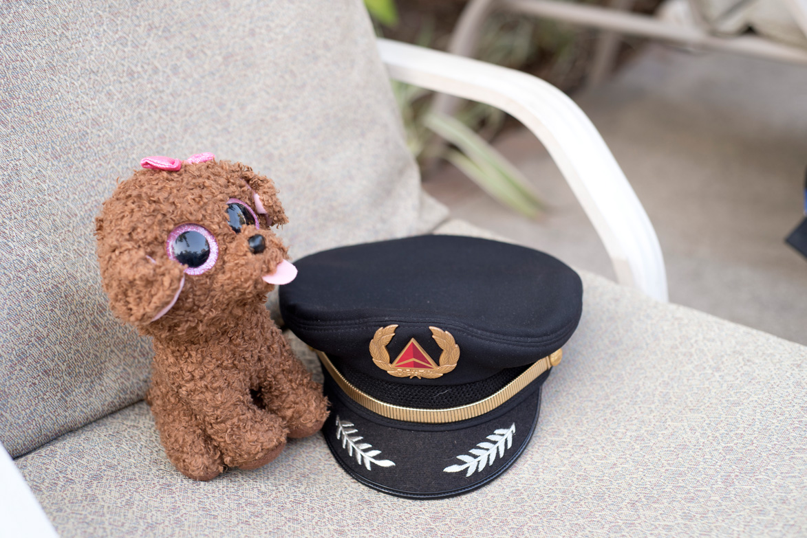 Delta pilot's hat and dog stuffed animal at Casa Cook in Tamarindo, Costa Rica. Photographed by Kristen M. Brown, Samba to the Sea Photography.