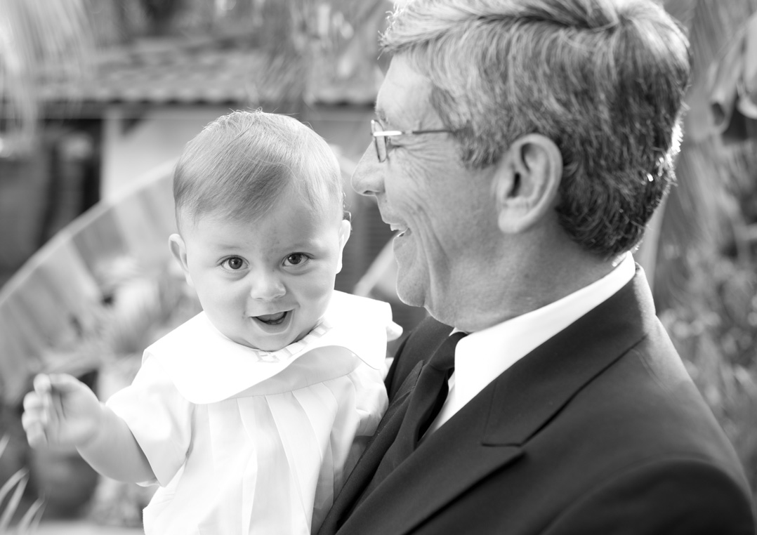 Grandfather and grandson black and white photo in by Tamarindo Family Photographer.