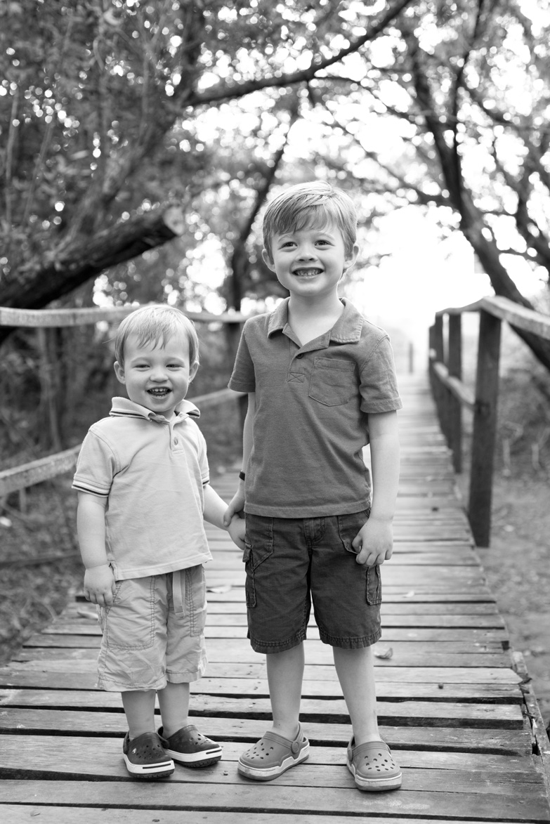 Young brother's holding hands on beach pathway to Tamarindo Beach, Costa Rica. Photographed by Kristen M. Brown, Samba to the Sea Photography.