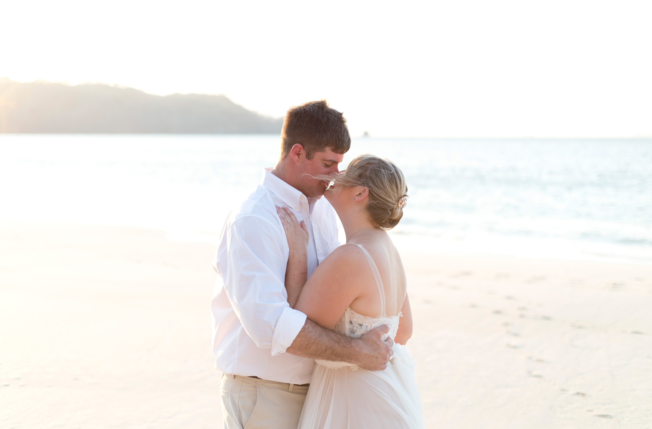 Bride and groom looking into each others eyes on the beach in Playa Conchal, Costa Rica. Photographed by Kristen M. Brown, Samba to the Sea Photography.