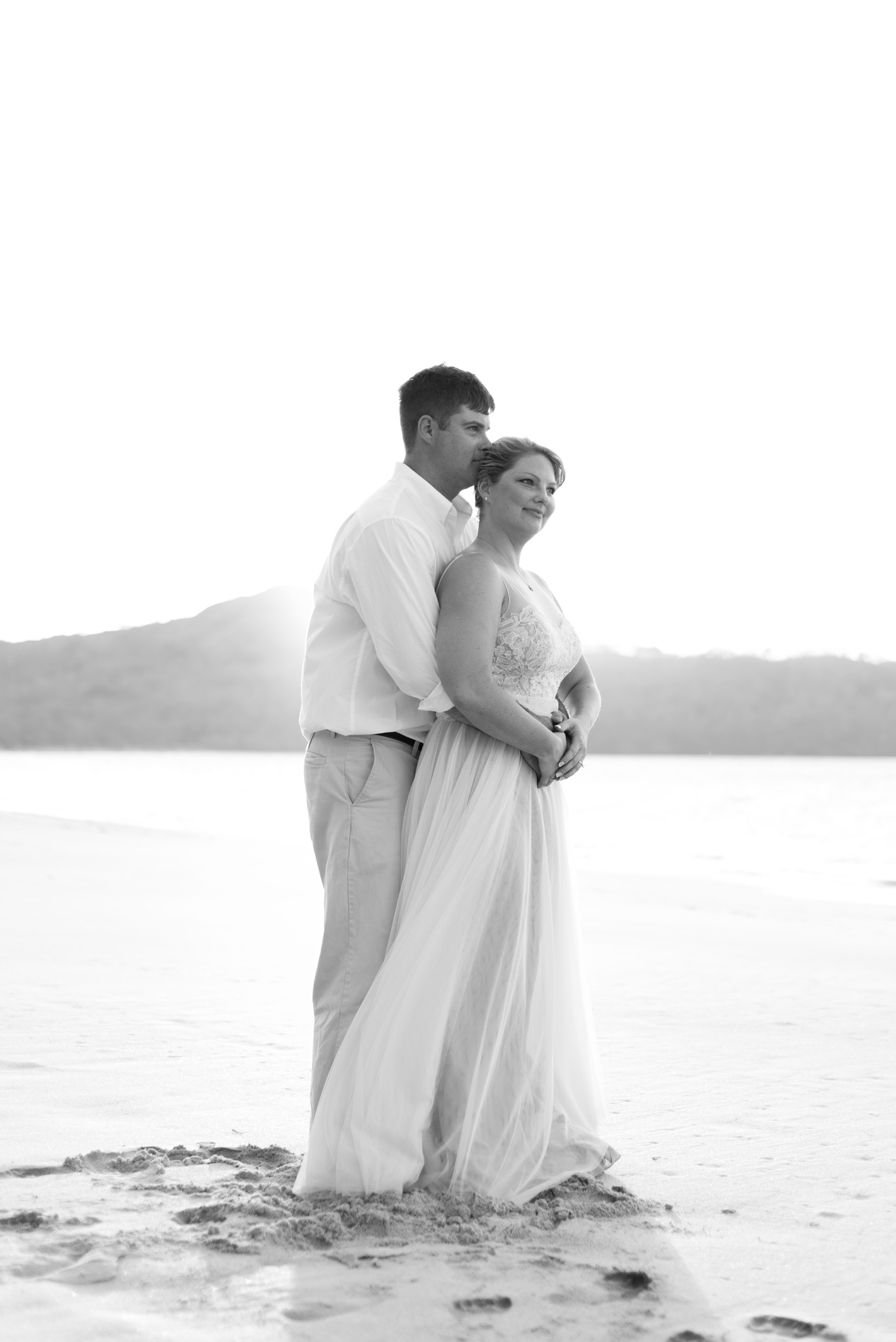 Black and white photo of bride and groom on Playa Conchal Costa Rica Wedding. Photographed by Kristen M. Brown, Samba to the Sea Photography.
