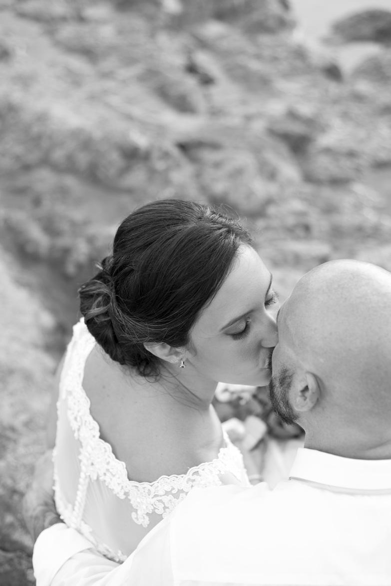 Bride kissing groom in Playa Langosta, Costa Rica