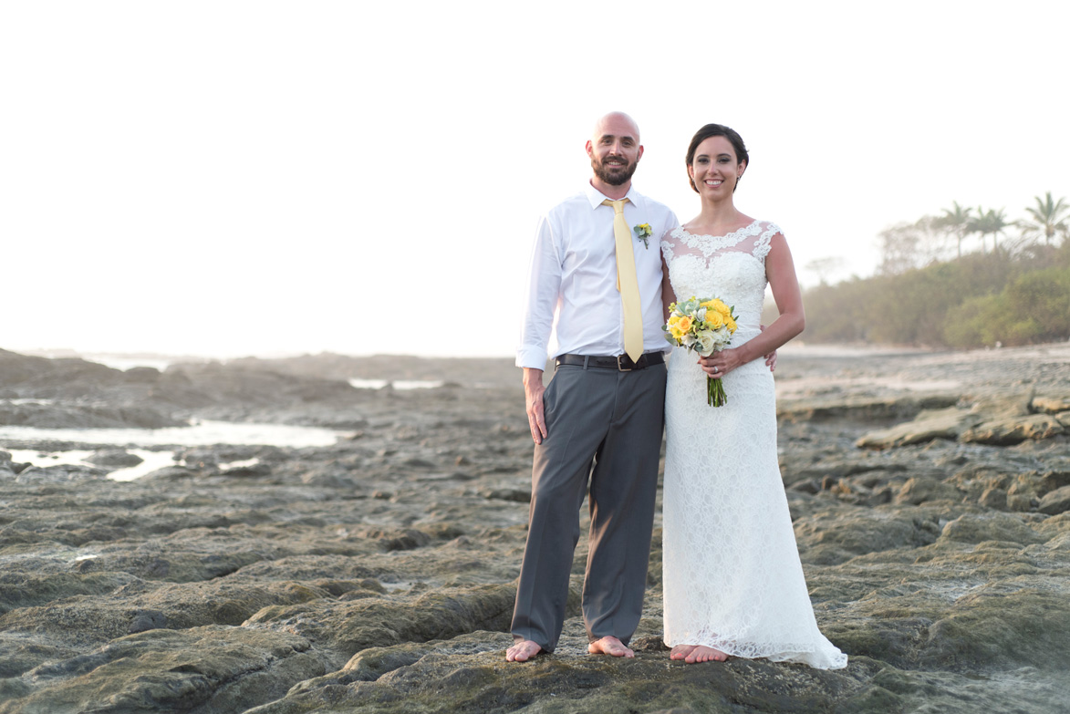 Bride and groom smiling at the camera during Elopement in Playa Langosta, Costa Rica