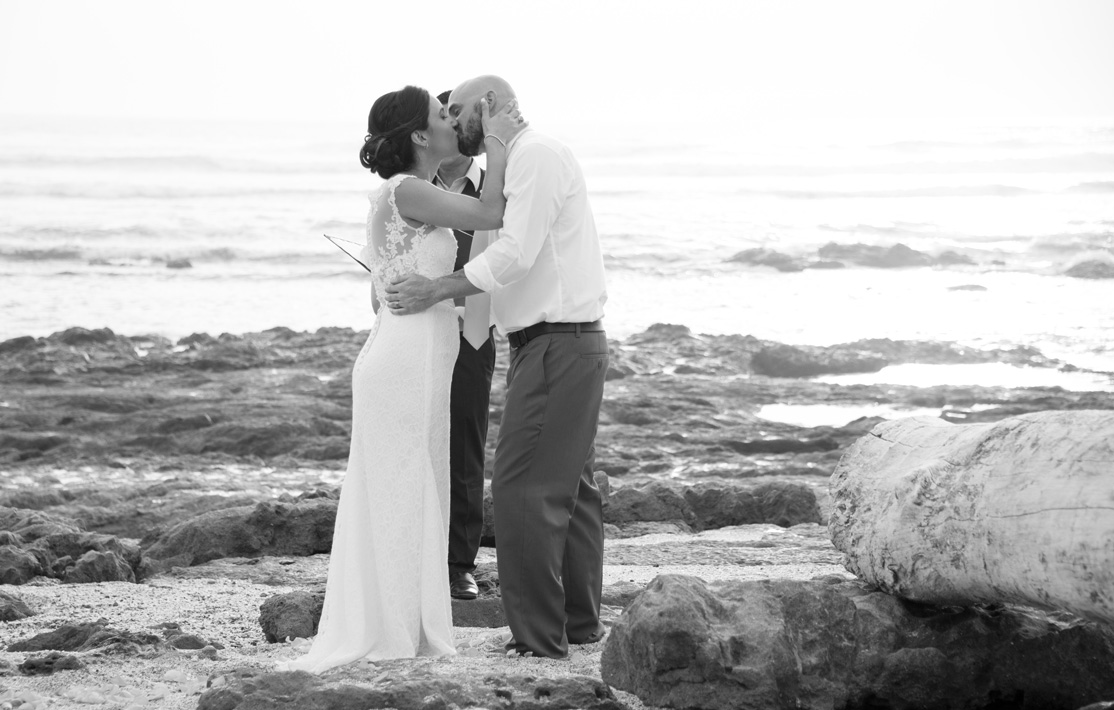First kiss during Elopement in Playa Langosta, Costa Rica