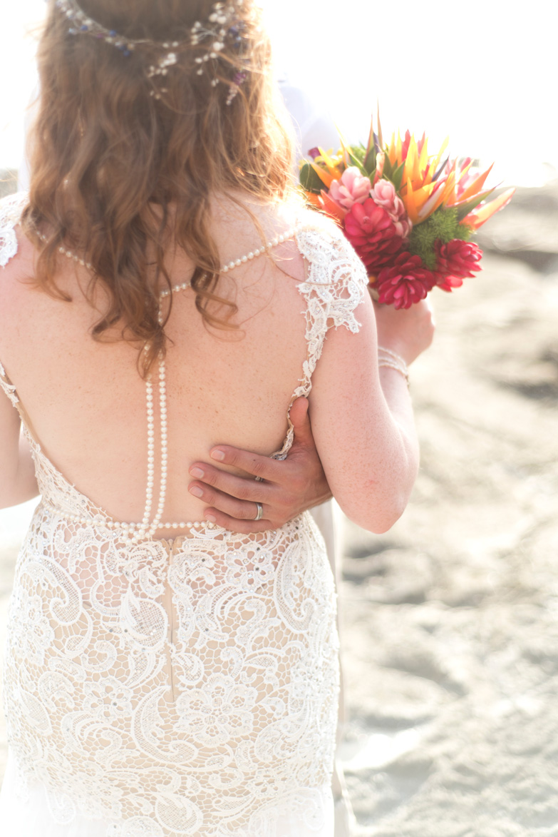 Boho Chic wedding dress detail at wedding at Playa Hermosa, Costa Rica. Photographed by Kristen M. Brown, Samba to the Sea Photography.