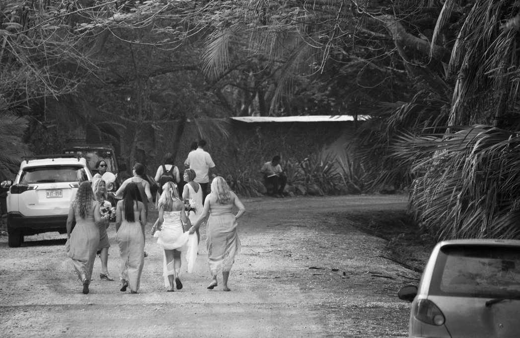 Bride and bridesmaids heading to the beach for wedding in Playa Langosta, Costa Rica. Photographed by Kristen M. Brown, Samba to the Sea Photography.
