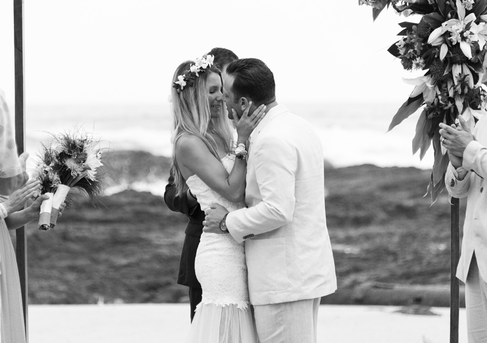 Bride and groom after first kiss at wedding in Playa Langosta, Costa Rica. Photographed by Kristen M. Brown, Samba to the Sea Photography.