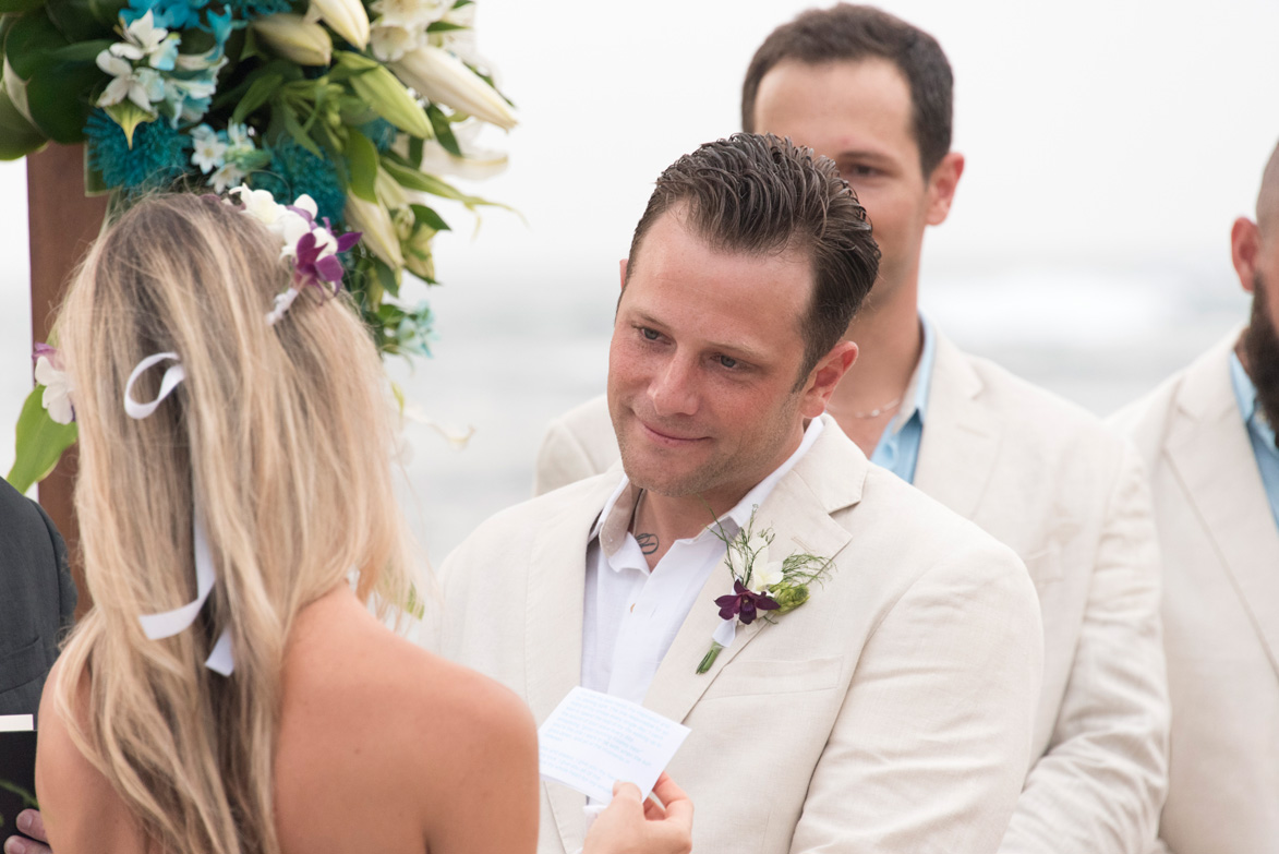 Emotional moment for groom as bride says her vows at beach wedding on Playa Langosta, Costa Rica Photographed by Kristen M. Brown, Samba to the Sea Photography.