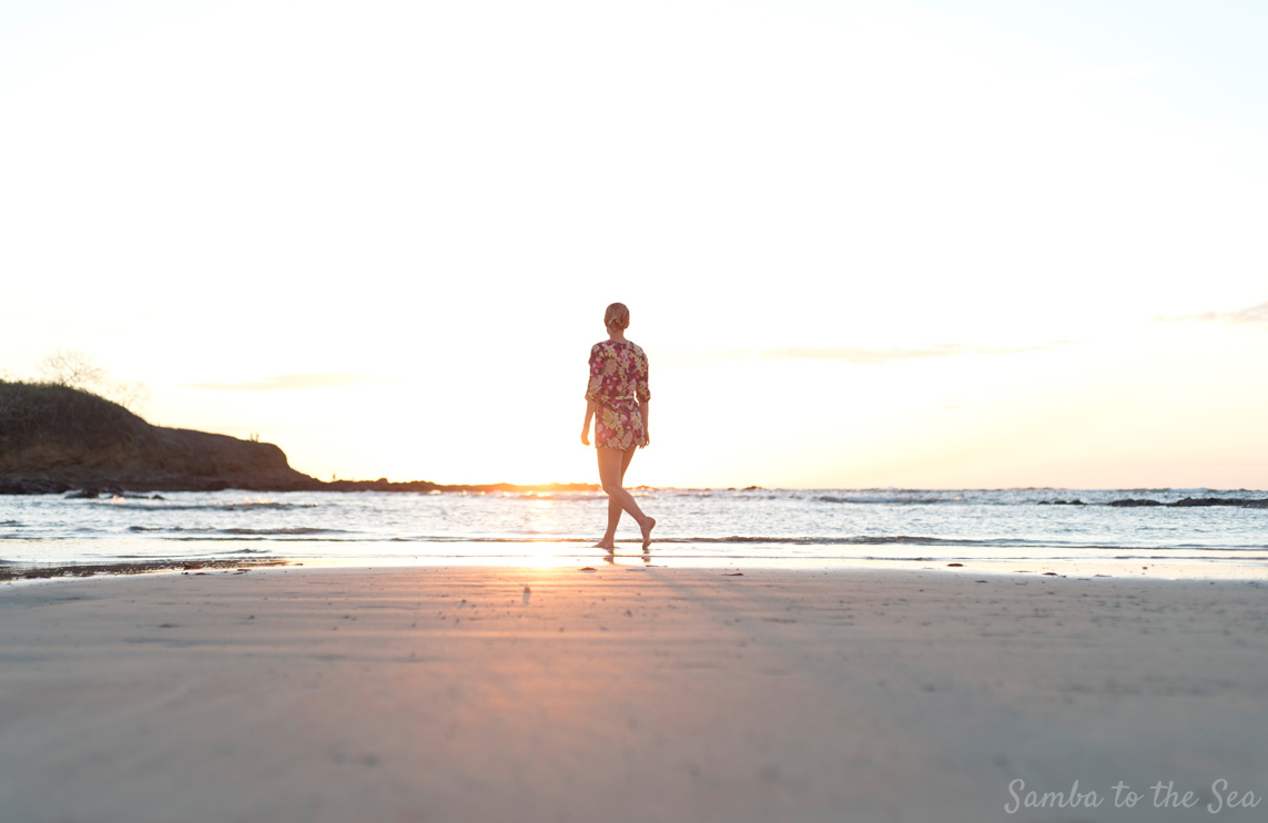 Theresa walking on the beach during sunset in Tamarindo, Costa Rica. Theresa is wearing Yumi Kim. Photographed by Kristen M. Brown, Samba to the Sea Photography.