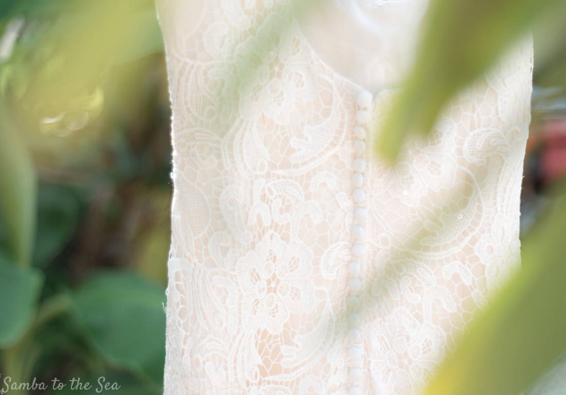 Lace wedding dress detail in Nosara, Costa Rica. Photographed by Kristen M. Brown, Samba to the Sea Photography.