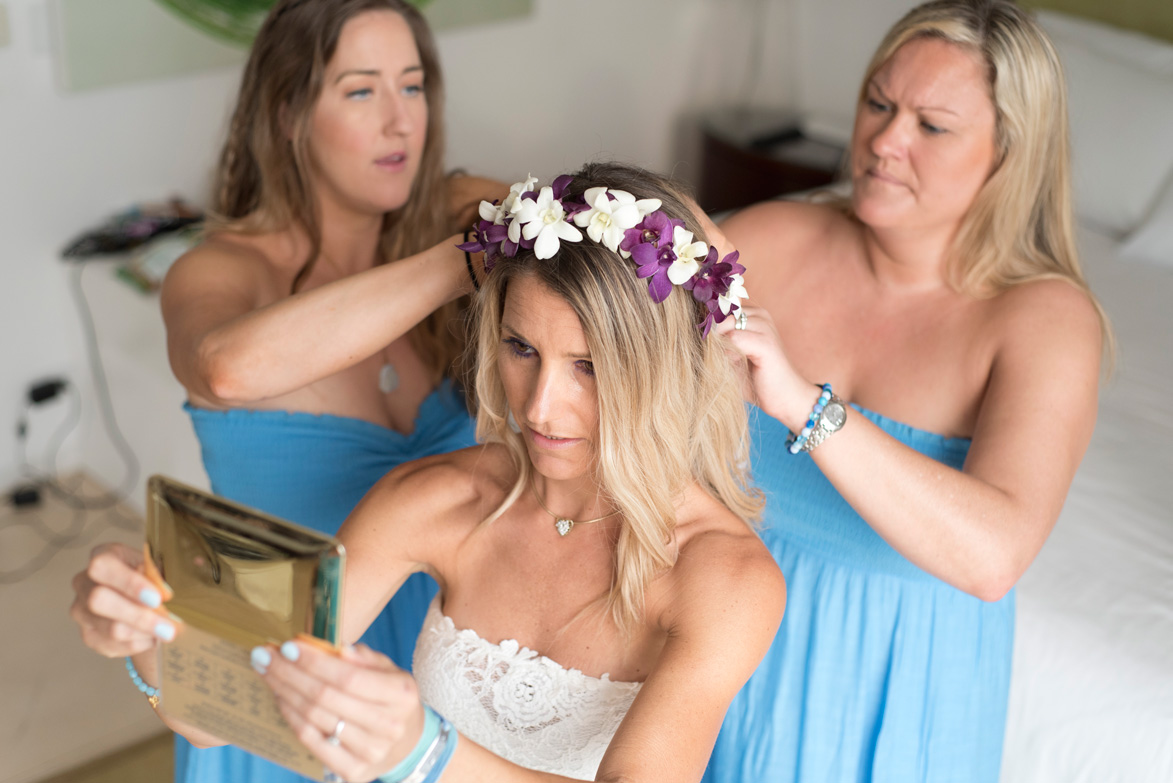 Bridesmaids putting on orchid flower crown on bride at Casa Cristal in Playa Langosta, Costa Rica. Photographed by Kristen M. Brown, Samba to the Sea Photography.