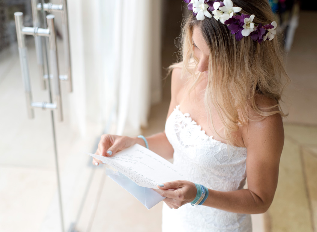Bride reading card from groom at Casa Cristal in Playa Langosta, Costa Rica. Photographed by Kristen M. Brown, Samba to the Sea Photography.