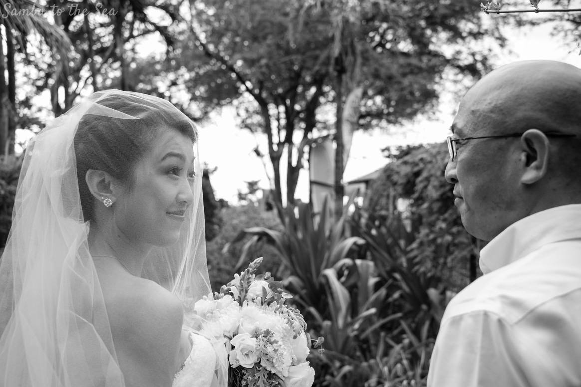 Bride and her father before she walks down the aisle at her Langosta Beach Club wedding. Photographed by Kristen M. Brown, Samba to the Sea Photography.