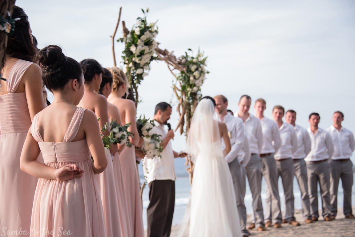 Junior bridesmaid crossing her fingers for luck during her sister's Langosta Beach Club wedding in Tamarindo, Costa Rica. Photographed by Kristen M. Brown, Samba to the Sea Photography.