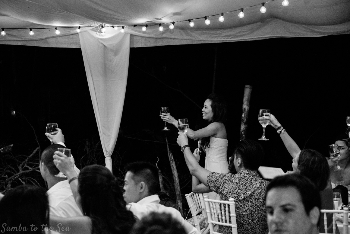 Maid of honor toasting the bride and groom at their wedding in Tamarindo, Costa Rica. Photographed by Kristen M. Brown, Samba to the Sea Photography.