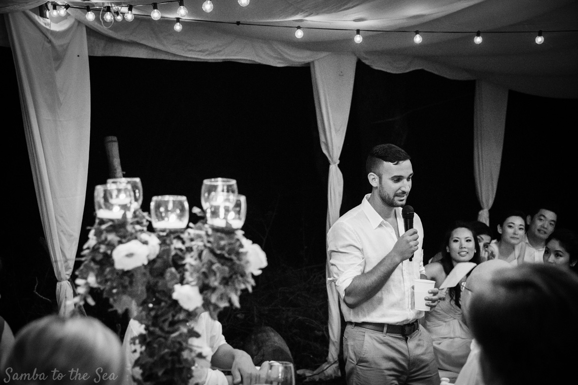 Best man giving his speech during a wedding in Tamarindo, Costa Rica. Photographed by Kristen M. Brown, Samba to the Sea Photography.