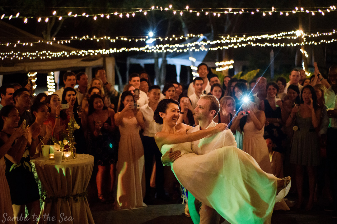 Bride and groom's first dance at Langosta Beach Club in Tamarindo, Costa Rica. Photographed by Kristen M. Brown, Samba to the Sea Photography.