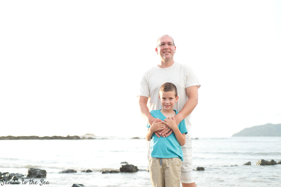 Father and young son on the beach in Tamarindo, Costa Rica. Photographed by Kristen M. Brown, Samba to the Sea Photography.