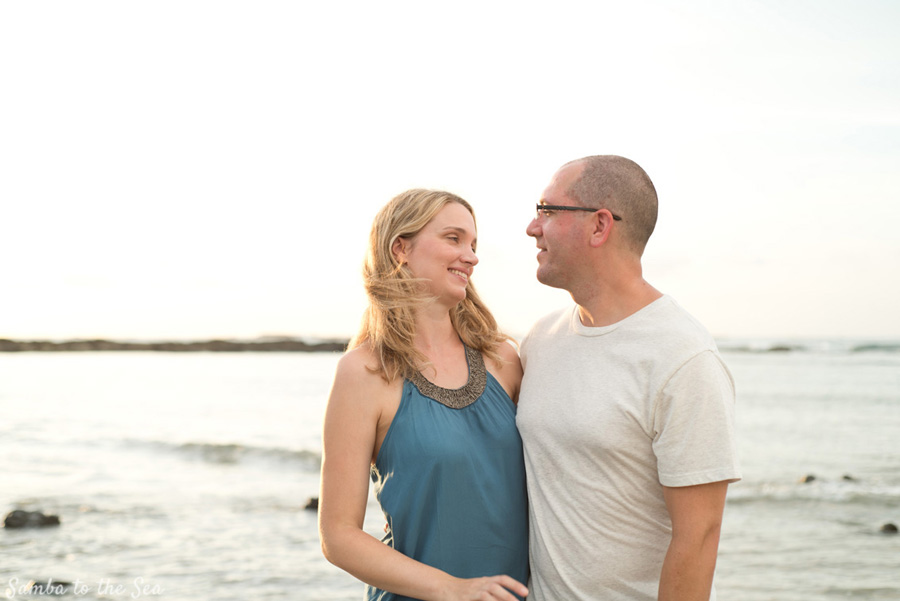 Husband and wife laughing during family photos in Tamarindo, Costa Rica. Photographed by Kristen M. Brown, Samba to the Sea Photography.