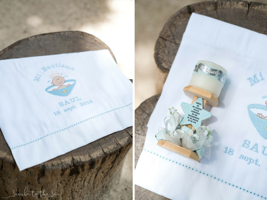 Baptism towel and candle for Saul's baptism at Santa Maria Church in Tamarindo, Costa Rica. Photographed by Kristen M. Brown, Samba to the Sea Photography.