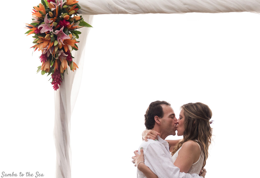 First kiss during Costa Rica elopement. Photographed by Kristen M. Brown, Samba to the Sea Photography.