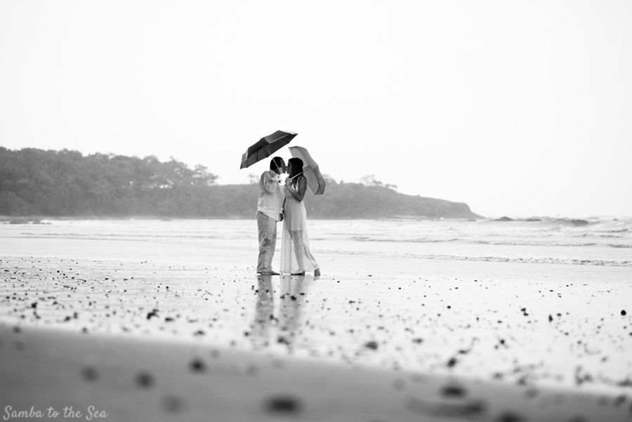 Beautiful photo of groom kissing his bride on the beach in Tamarindo, Costa Rica. Photographed by Kristen M. Brown, Samba to the Sea Photography.
