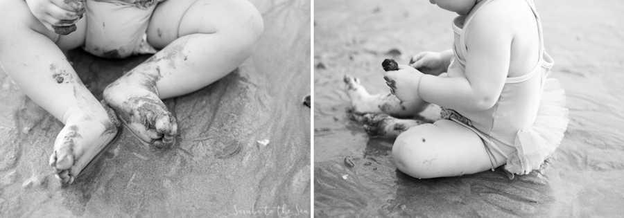 Black and white photo of eight month old baby girl playing in the sand in Costa Rica. Photographed by Kristen M. Brown, Samba to the Sea Photography.