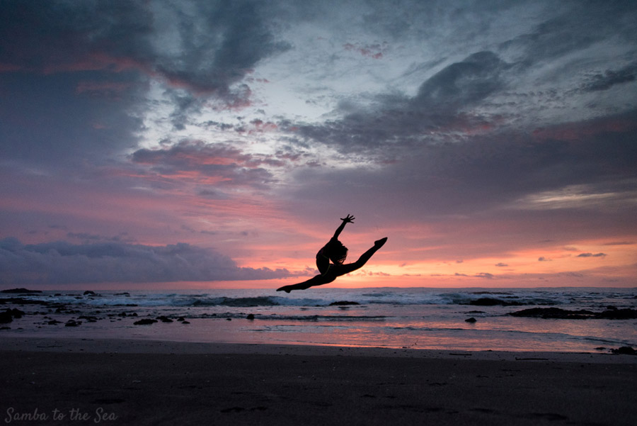 Young dancer doing a jump on the beach during a gorgeous sunset in Playa Junquillal, Costa Rica. Photographed by Kristen M. Brown, Samba to the Sea Photography.