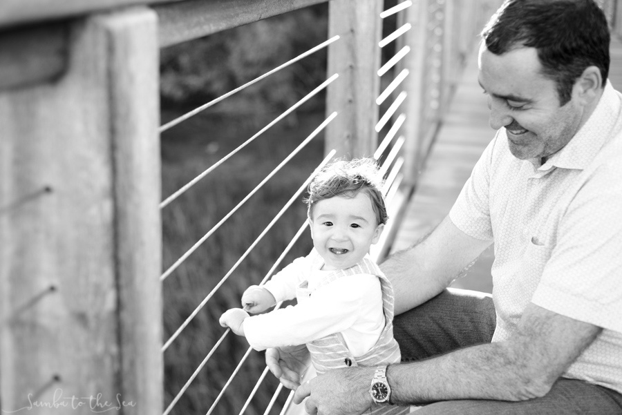 Young boy and his father playing on the dock in Palmetto Bluff, South Carolina. Photographed by Savannah Family Photographer, Kristen M. Brown, Samba to the Sea Photography.