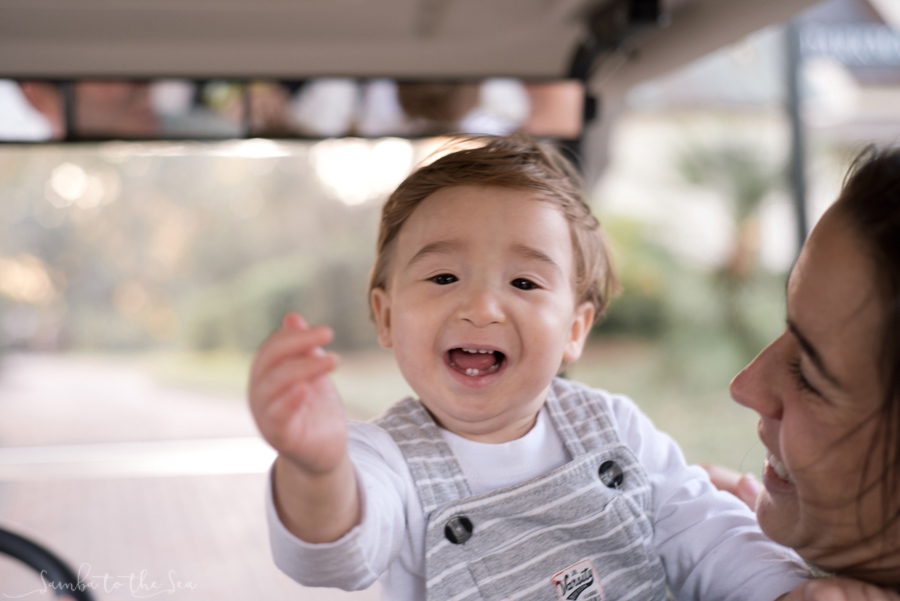 Young boy loving riding in the golf cart with his parents at the Montage Palmetto Bluff in Bluffton, South Carolina. Photographed by Savannah Family Photographer, Kristen M. Brown, Samba to the Sea Photography.