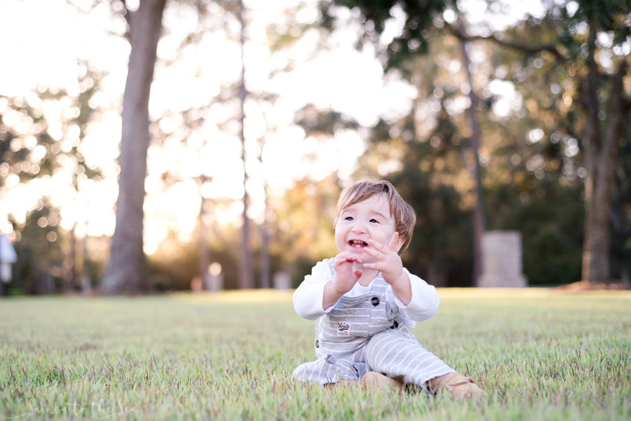 Young boy playing in the grass at the Montage Palmetto Bluff in Bluffton, South Carolina. Photographed by Savannah Family Photographer, Kristen M. Brown, Samba to the Sea Photography.