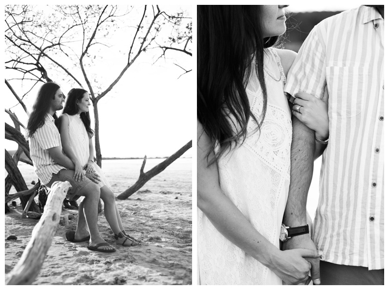 Black and white photo of couple during their engagement photos on the beach in Costa Rica. Girlfriend is wearing an boho chic dress from Free People. Photographed by Kristen M. Brown, Samba to the Sea Photography.