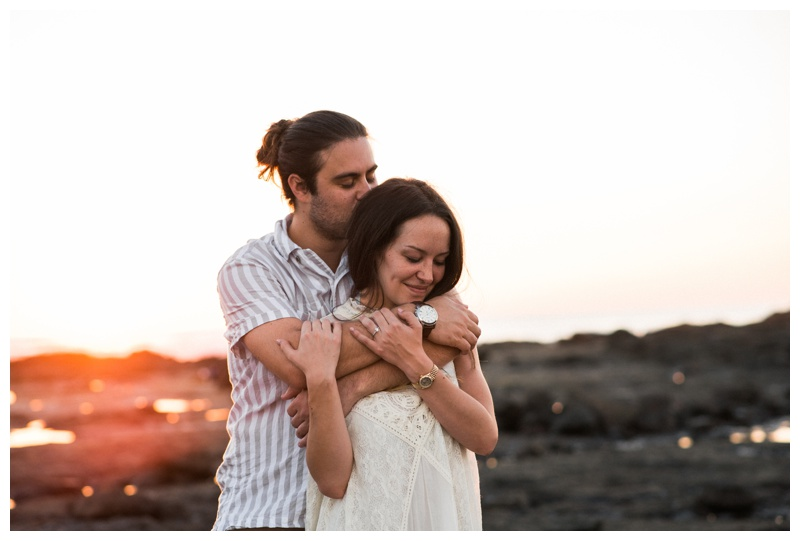 Fiancé hugging his girlfriend during engagement photos on the beach in Costa Rica. Photographed by Kristen M. Brown, Samba to the Sea Photography.