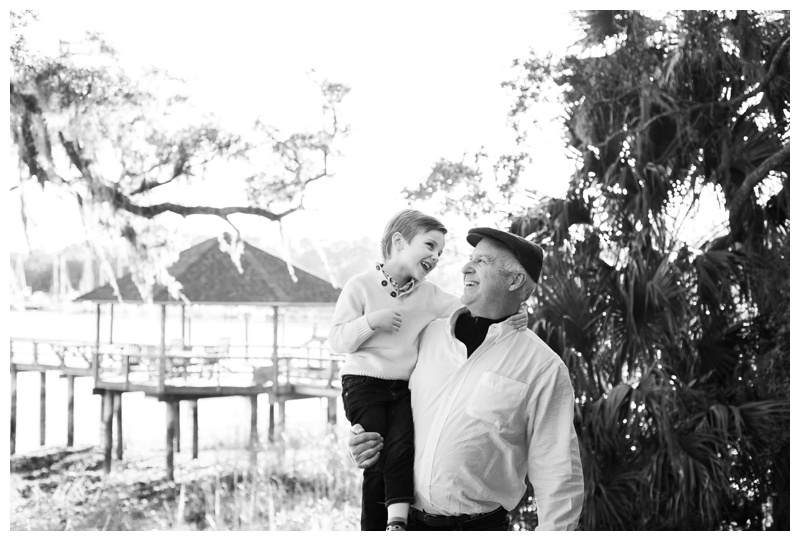 Grandfather and grandson laughing during family portraits in Savannah, GA. Photographed by Kristen M. Brown, Samba to the Sea Photography.