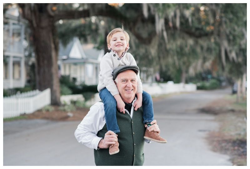 Grandson sitting on his grandfather's shoulders during family photos in Isle of Hope, GA. Photographed by Kristen M. Brown, Samba to the Sea Photography.