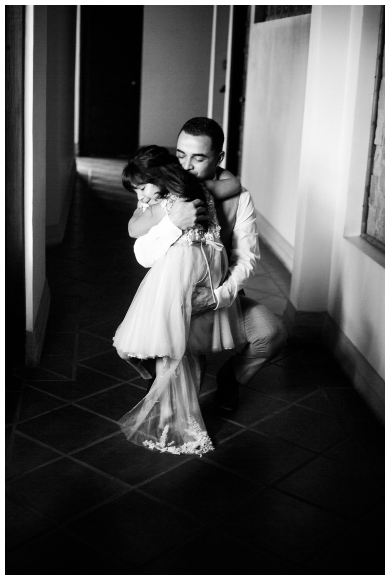 Groom hugging his daughter in Playa Langosta, Costa Rica. Photographed by Kristen M. Brown, Samba to the Sea Photography.